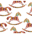 Seamless pattern with rocking horses vector image