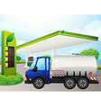 An oil tanker in front of a gasoline station vector image vector image