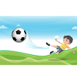 A boy playing football at the hills vector image vector image