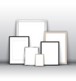 blank picture frames against a wall vector image