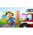 A fireman with a hose at the street vector image