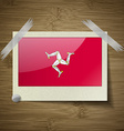 Flags of Isle of man at frame on wooden texture vector image