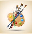 Palette with paint brushes vector image
