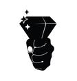 diamond in hand on black vector image