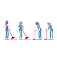 set of male and female janitor sweeping the floor vector image