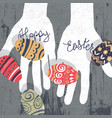 Easter eggs in hands silhouette on wooden board vector image
