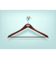 Clothes Wooden Hanger with Metal Tag on Background vector image