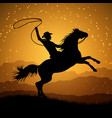 silhouette of cowboy with lasso on rearing horse vector image