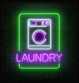 neon glowing laundry signboard on dark brick wall vector image