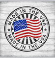 made in the usa stamp on wooden background vector image