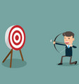 determined handsome businessman aiming at target vector image
