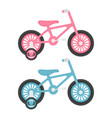 set of two pink and blue kids bicycles isolated on vector image