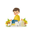 cute little boy in warm clothing sitting on the vector image