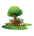 A boy sitting under the big tree vector image