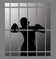 man in prison or dark dungeon behind bars vector image