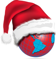 red globe in a christmas hat vector image vector image