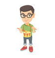 cheerful caucasian boy in glasses playing the drum vector image