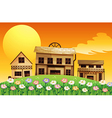 A sunset scene with wooden houses vector image vector image