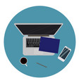 laptop and office supplies laying on the board vector image