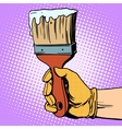 Painting brush in his hand vector image