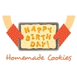 Happy birthday cookies on a pan in hands vector image