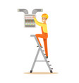 electrician standing on a stepladder and screwing vector image