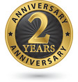 2 years anniversary gold label vector image