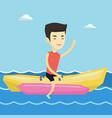tourists riding a banana boat vector image