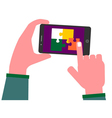Solving puzzle pieces on a smart phone vector image
