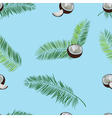 Coconut palm leaves seamless pattern on blue vector image