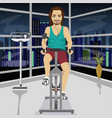 young man on an exercise bike in gym in evening vector image