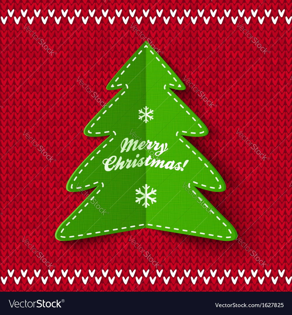 Green christmas tree on red knitted background vector