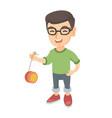 caucasian boy in glasses playing with yo-yo vector image