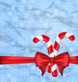 Christmas background with gift bow and sweet canes vector image