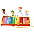 children jumping on giant xylophone vector image