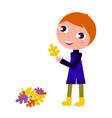 cute little autumn boy holding leaf vector image