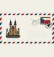 an envelope with postage stamp with prague church vector image