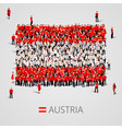 large group of people in the austria flag shape vector image