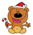 Christmas Teddy Bear Holding A Candy Cane vector image