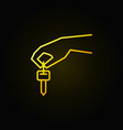 hand holding car key yellow icon vector image