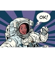 OK gesture woman astronaut in a spacesuit vector image