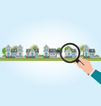 magnifying glass in human hand with house icon vector image