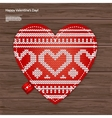 Valentines kniited heart on a wood background vector image vector image