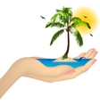 Sea island with palm in a female hand vector image