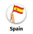 spain flag in hand round icon vector image