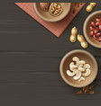 different nuts in bowls vector image vector image