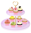 A cupcake stand with cupcakes vector image vector image