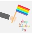 Businessman hand holding rainbow gay pride flag vector image vector image