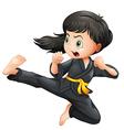 A brave girl doing karate vector image