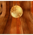 Gold bauble on rustic background EPS8 vector image